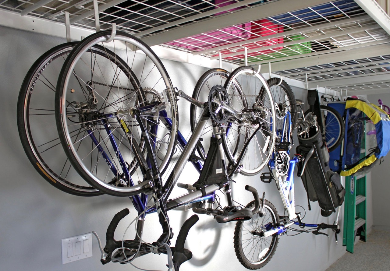 Optional hooks can attach to the bottom of the shelves to provide storage for bikes, tools, golf clubs & a variety of other items.